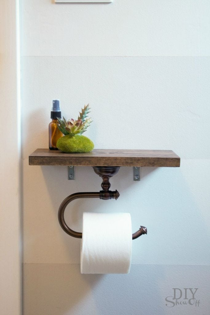 Toilet Paper Holder Talk about a unique and useful idea! This toilet paper holder is also a shelf that you can store air freshener, washcloths, cotton balls, or anything else you desire. It is a rustic style that goes with any other farmhouse decorations. Take a look at this one! thesawguy.com