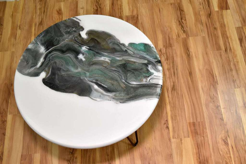 This epoxy resin table top is different because they used an existing small table and transformed it into a beautiful creation! So easy too! thesawguy.com