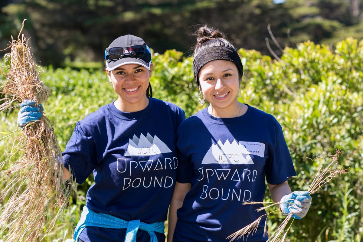 Volunteers from Outward Bound pull invasive grasses