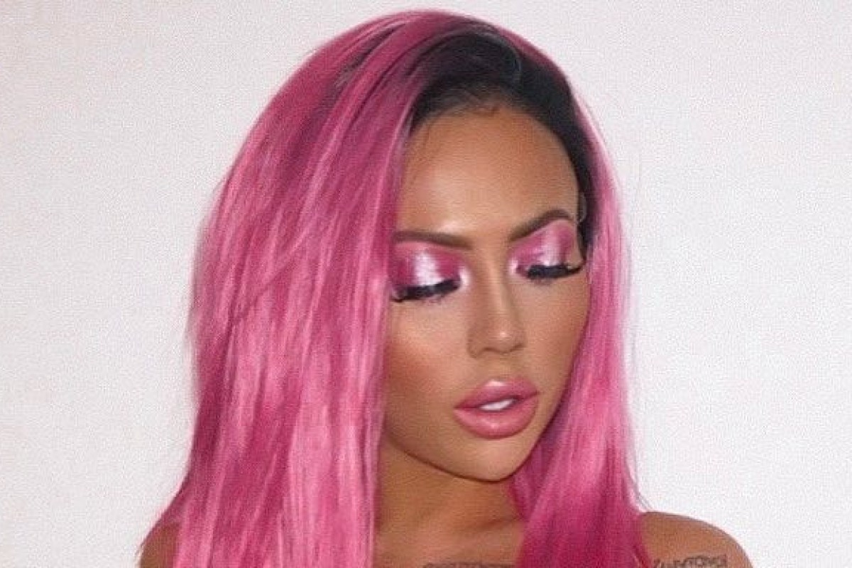 Holly Hagan looks unrecognisable as she shows off pink hair while stripping to her underwear
