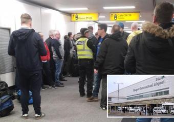 Los fanáticos de los Rangers en el caos del vuelo después de que los miembros de su equipo hayan sido despedidos del avión en el aeropuerto de Glasgow antes del choque del Rapid Vienna