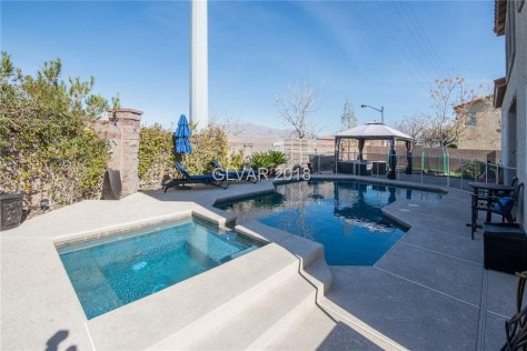 The luxury home boasts a solar-heated pool