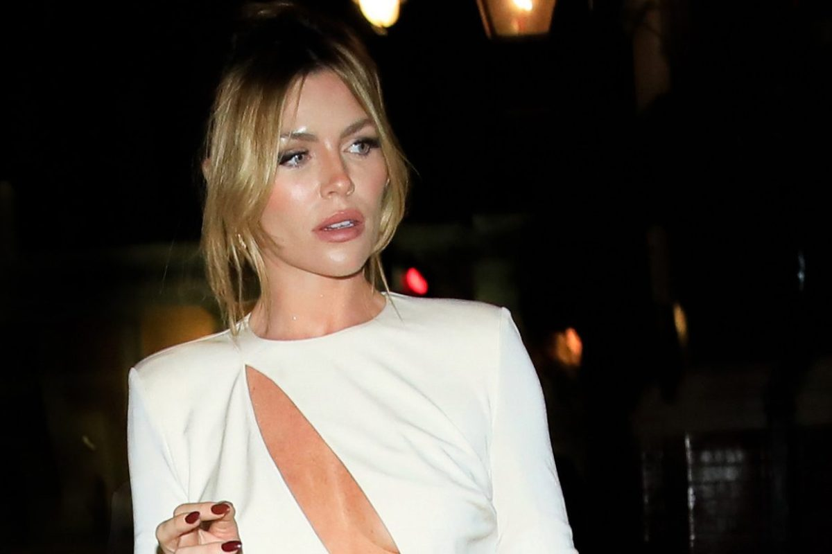 Abbey Clancy looks sensational in slashed white gown at London Fashion Week
