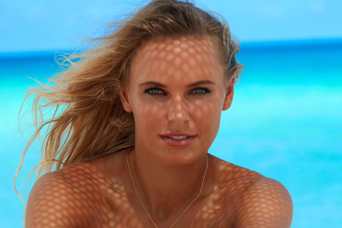 Tennis ace Caroline Wozniacki stuns as she bares all on the beach for Sports Illustrated photoshoot