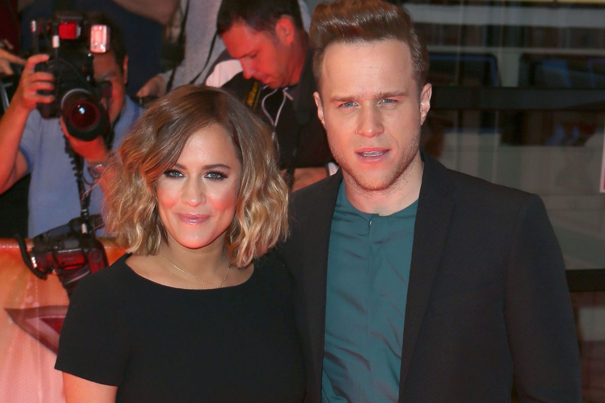 Olly Murs says Caroline Flack's death still 'doesn't seem real' and says grief has been 'tough'