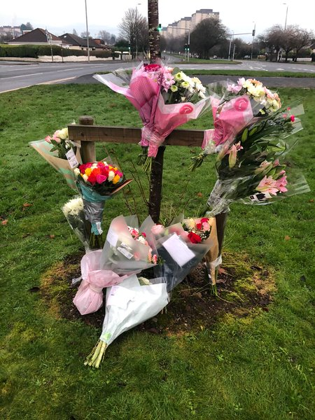Floral tributes were left at the scene of the smash