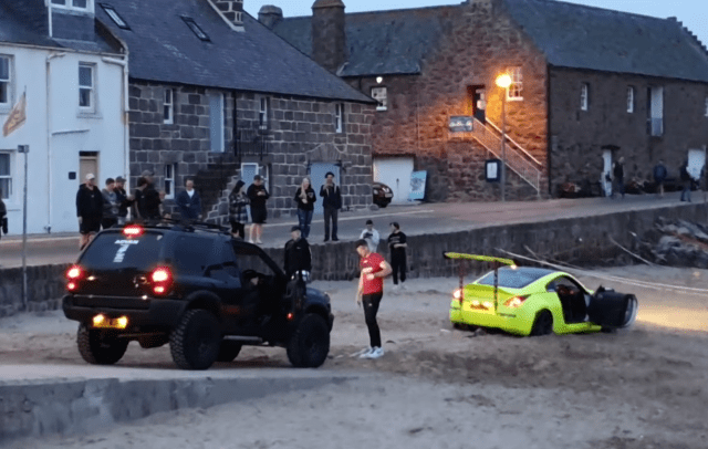 A 'show off' driver got his car stuck on the sand at Stonehaven harbour