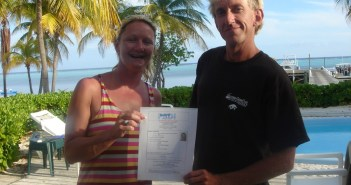 Paula Brazier receiving her certification from Mike Schouten at the Southern Cross Club on Little Cayman.