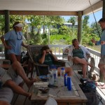 The Grouper Moon Project team, including Guy Harvey (R), conferencing on the porch of Peter Hillenbrand's house, base of operations during the study. Photo courtesy the Grouper Moon Project.