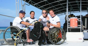 Aboard a spacious Red Sail Sports boat are from left to right Stay-Focused members: Brian Siemann, Jenn Poist, Gail Gaeng, and Tatyana McFadden. Brian and Gail are Stay-Focused mentors and will be in Grand Cayman again this summer diving