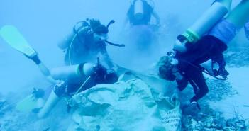 Volunteer divers removing rubble from the damaged coral reef. Photo courtesy Cayman Magic Reef Restoration Project