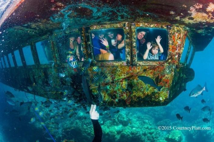 Schoolchildren enjoying an underwater ride aboard the Atlantis Submarine in George Town Harbour.