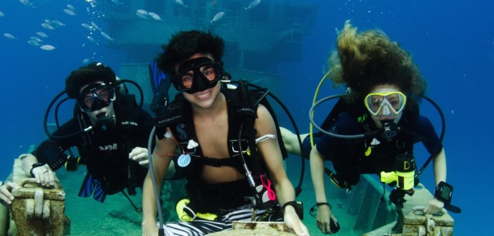 Diving parents and grandparents are introducing their kids to diving, making it a great family activity while on vacation. Photo courtesy Divetech