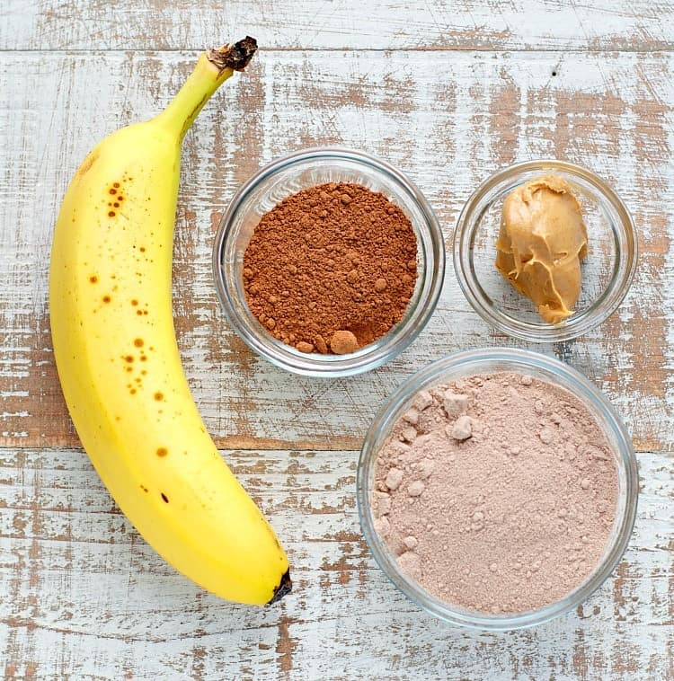 A healthy, high protein breakfast is less than 5 minutes away with this Chunky Monkey Protein Smoothie! Dairy-free, gluten-free, vegan, and loaded with chocolate, peanut butter, and banana goodness!