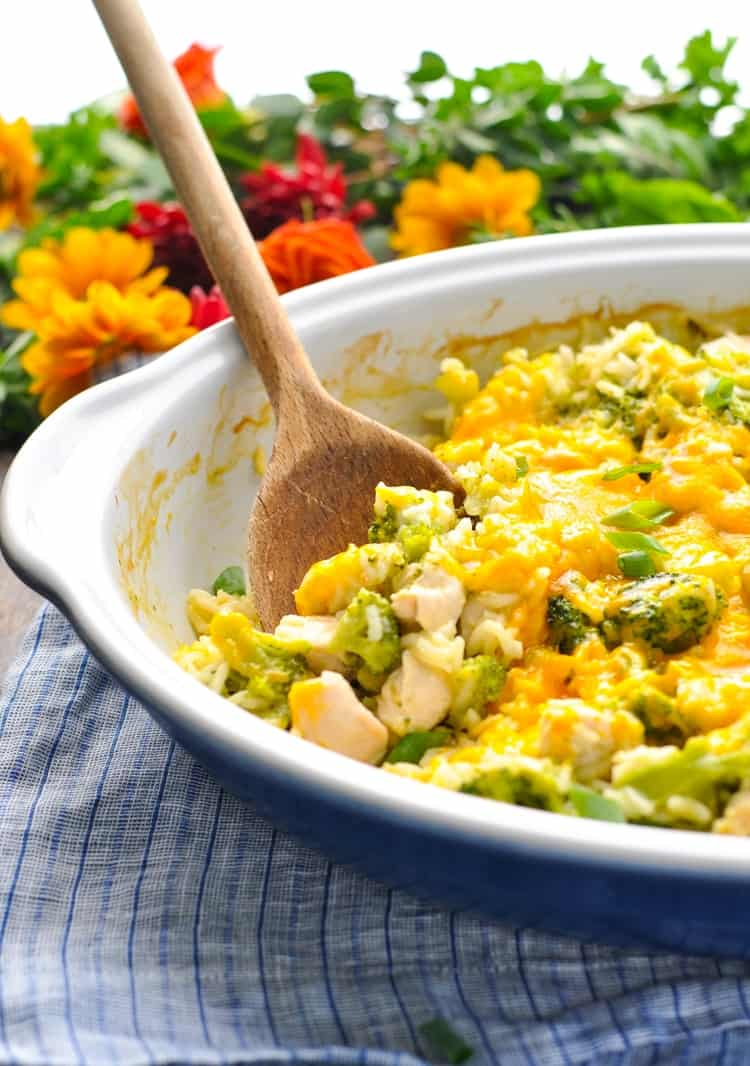 cheap meal ideas, chicken broccoli rice casserole with a wooden spoon
