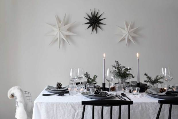 Minimalist Christmas table styling with fir, candles & pine cones | These Four Walls blog