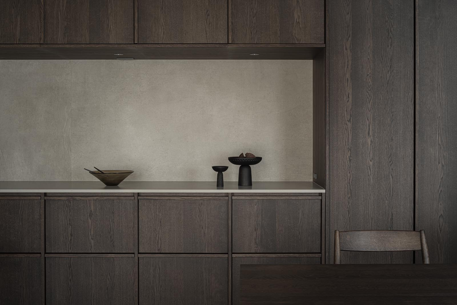 Japandi kitchen in dark wood and pale stone | Home tour - soft minimalism & earthy tones in Tokyo | These Four Walls blog