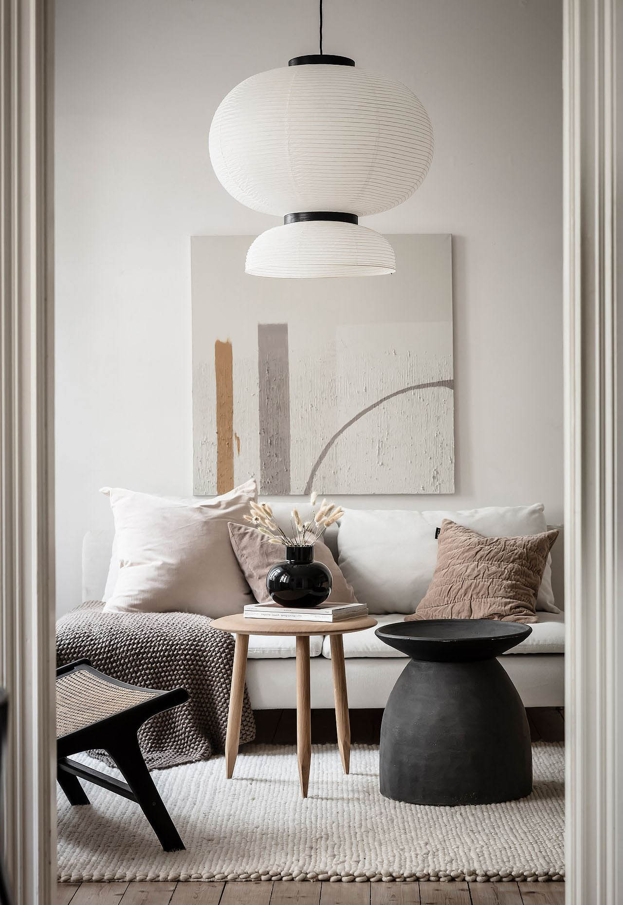 White living room with oversized paper pendant lamp, natural textures and earthy neutral accents   How to design a lighting scheme that works for you   These Four Walls blog