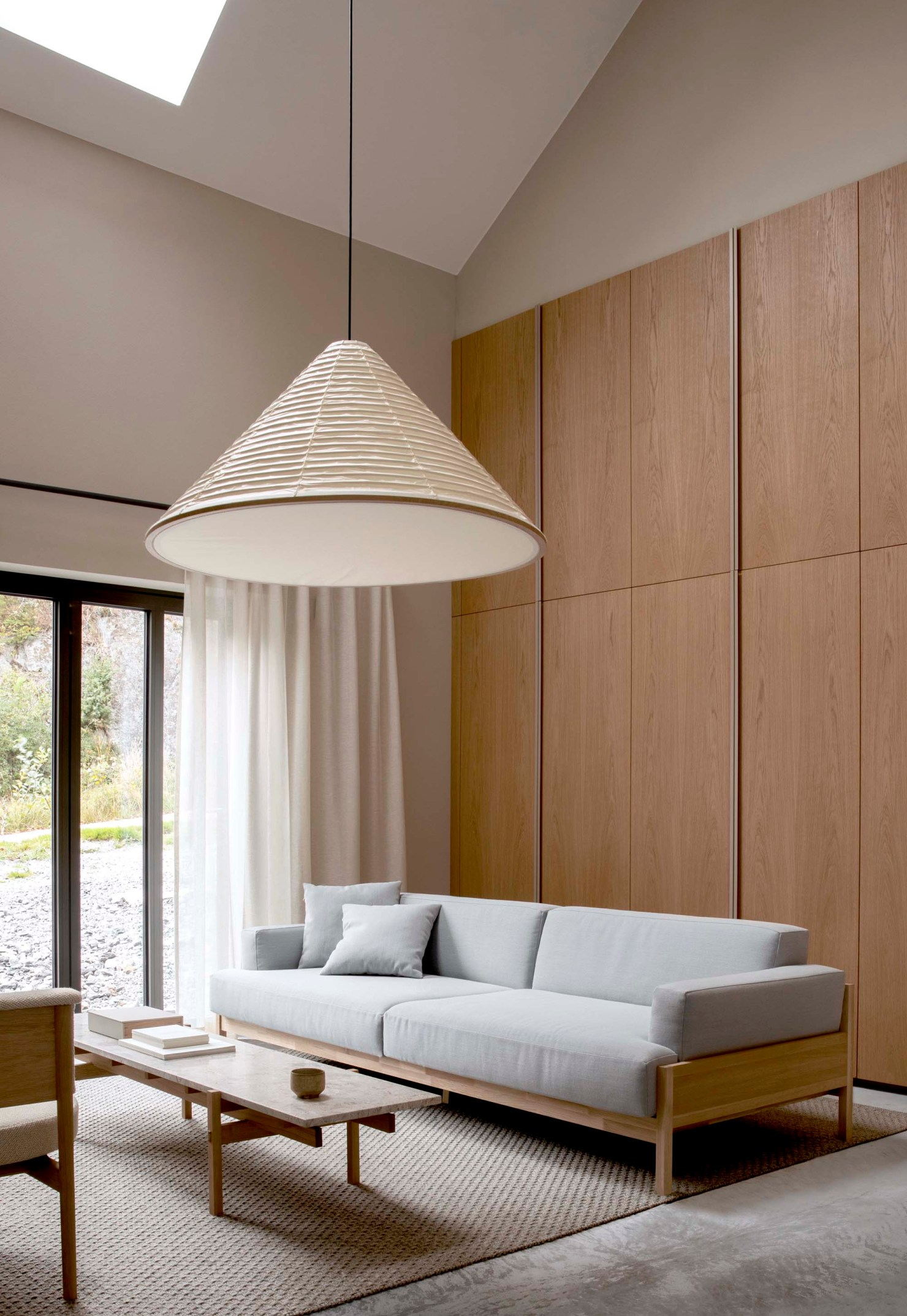 Japandi-style living room with panelled walls and oversized paper lampshade   How to design a lighting scheme that works for you   These Four Walls blog