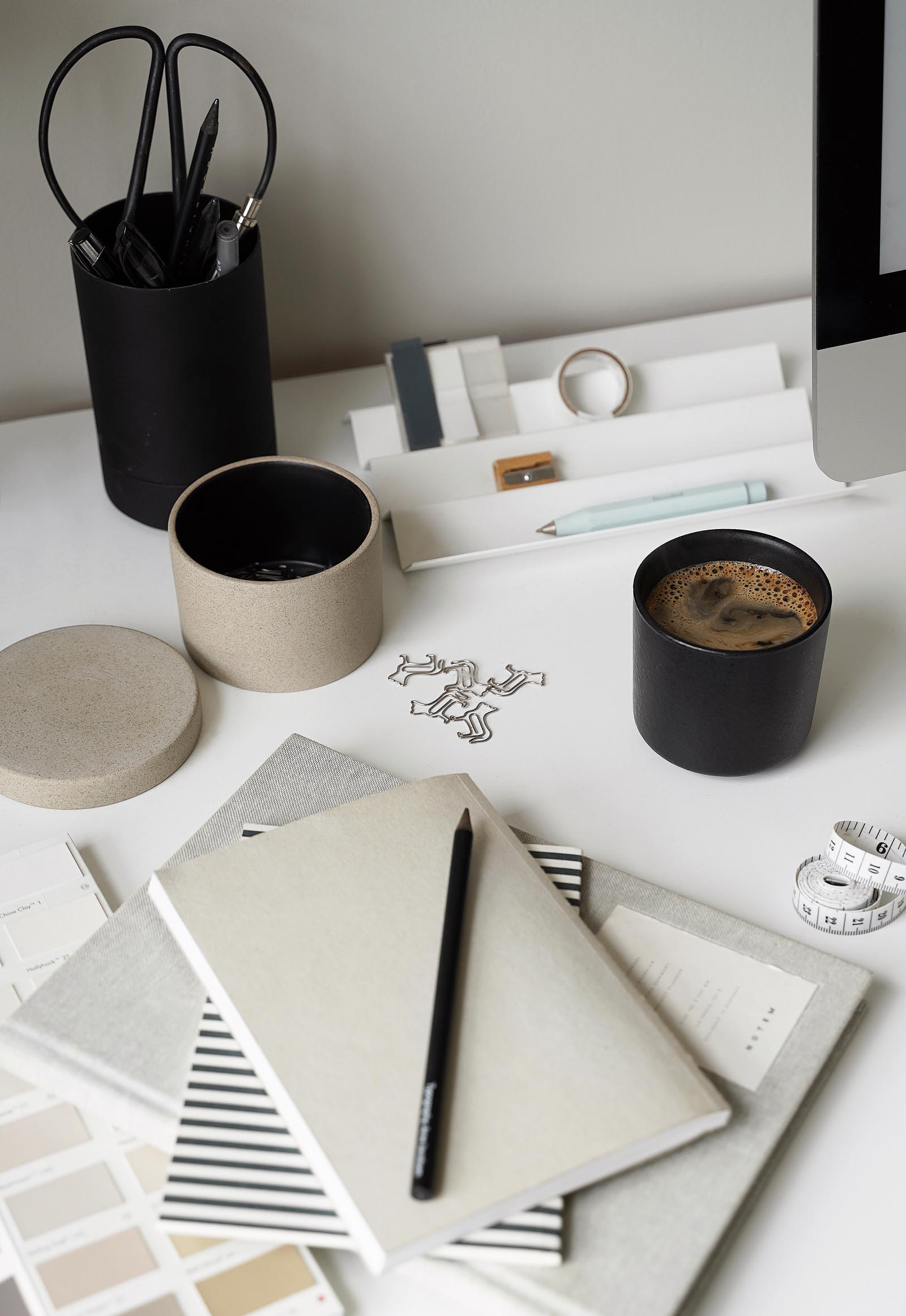 Minimalist desk accessories in a calming grey and beige home office | These Four Walls blog