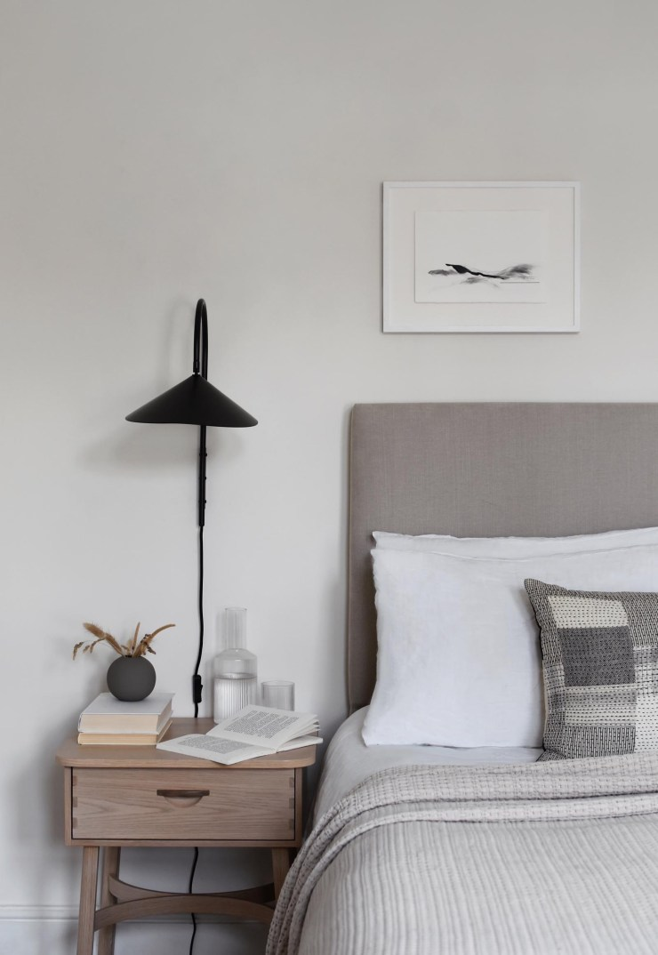 Minimalist white and beige bedroom with temperature-control bedding from The Fine Bedding Company | These Four Walls blog