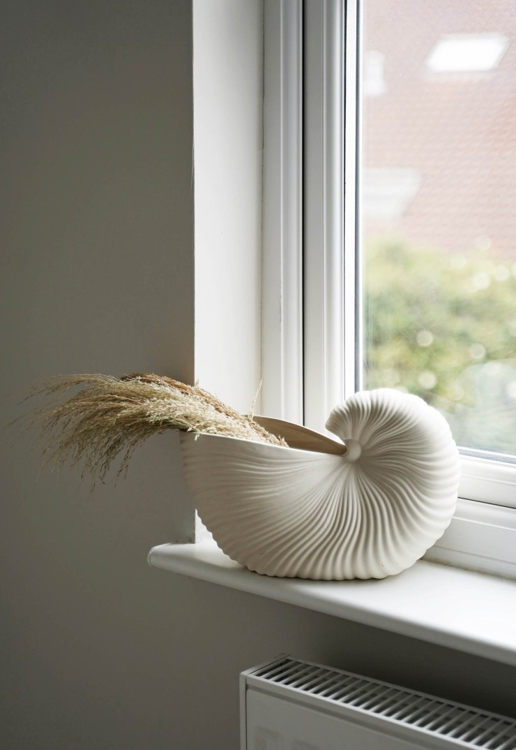 Ferm Living shell vase filled with dried grasses   These Four Walls blog