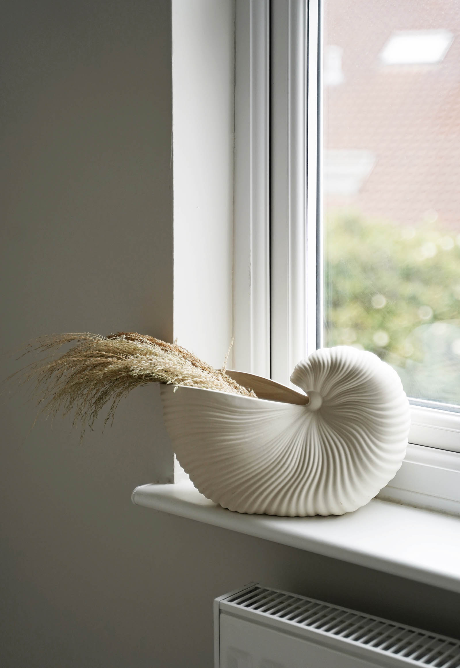 Ferm Living shell vase filled with dried grasses | These Four Walls blog