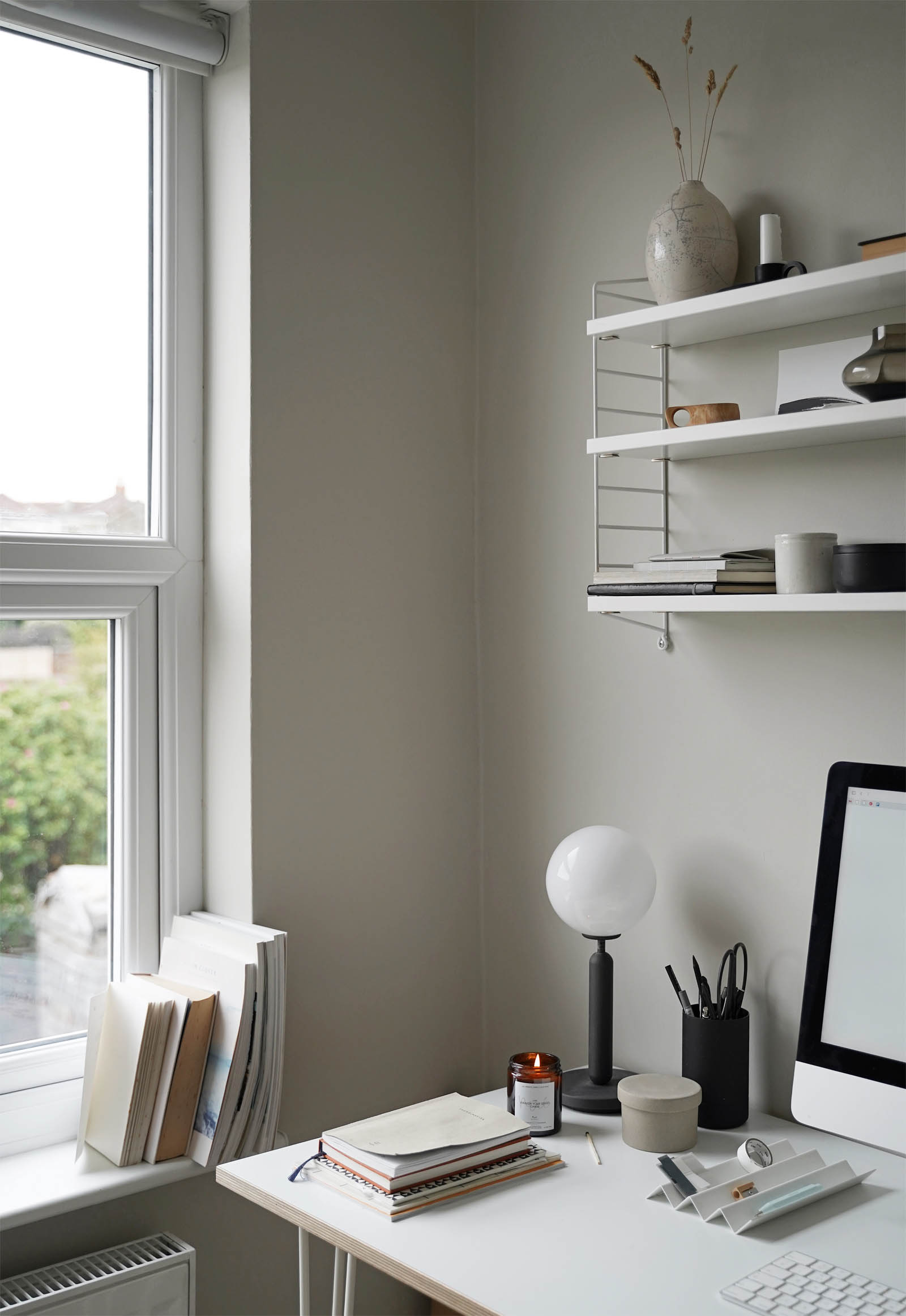 Organised desk setup in a minimalist home office decorated in soft grey and beige | These Four Walls blog