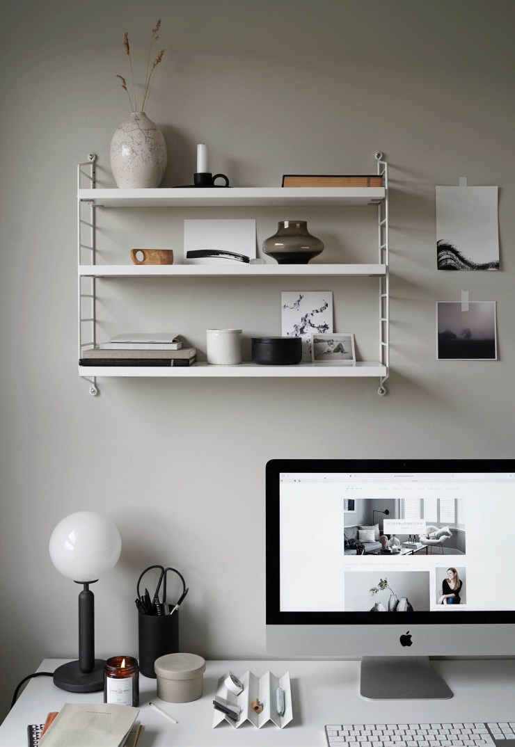 Minimalist desk setup and String Pocket shelving display in a calming grey home office   These Four Walls blog
