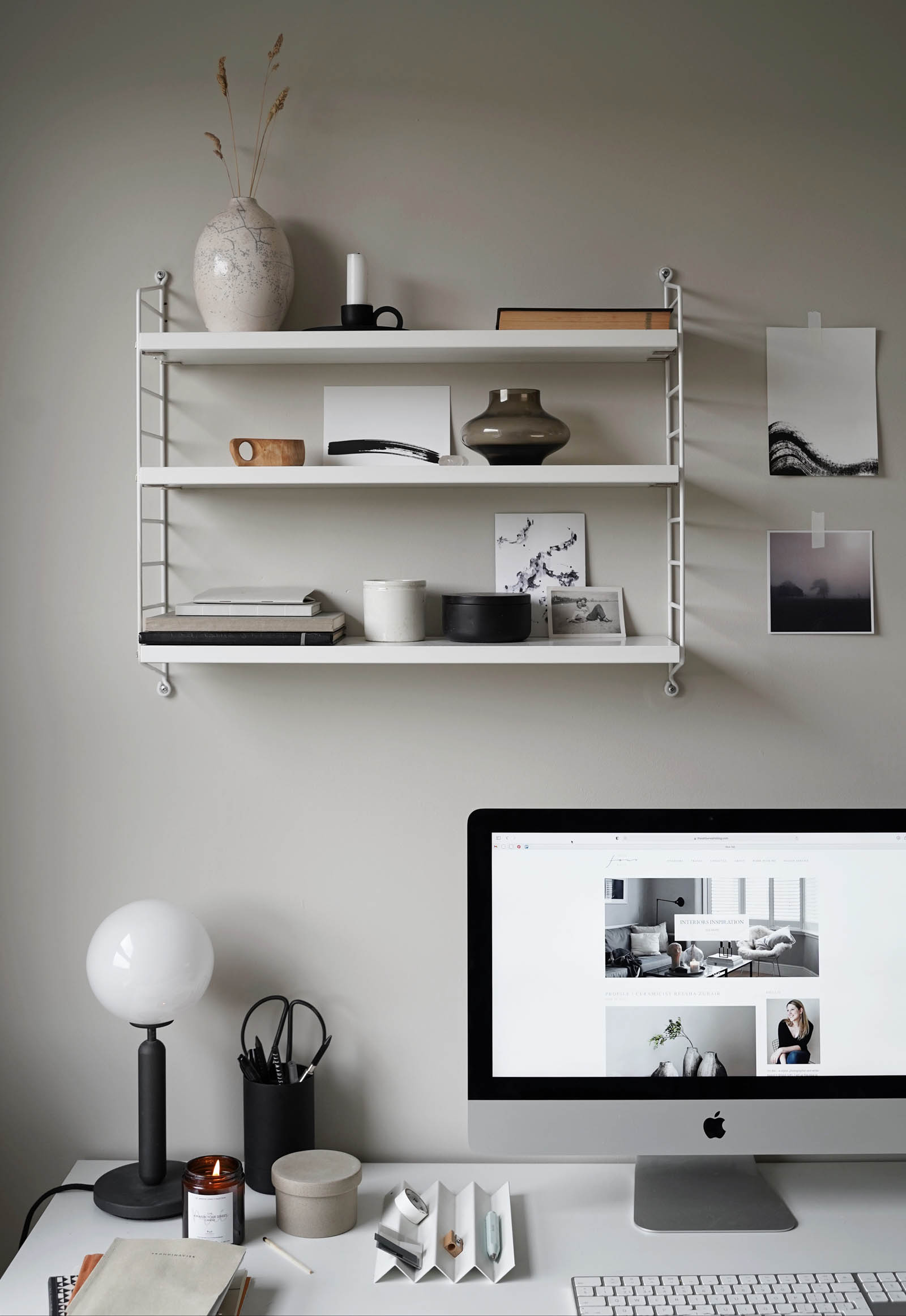 Minimalist desk setup and String Pocket shelving display in a calming grey home office | These Four Walls blog