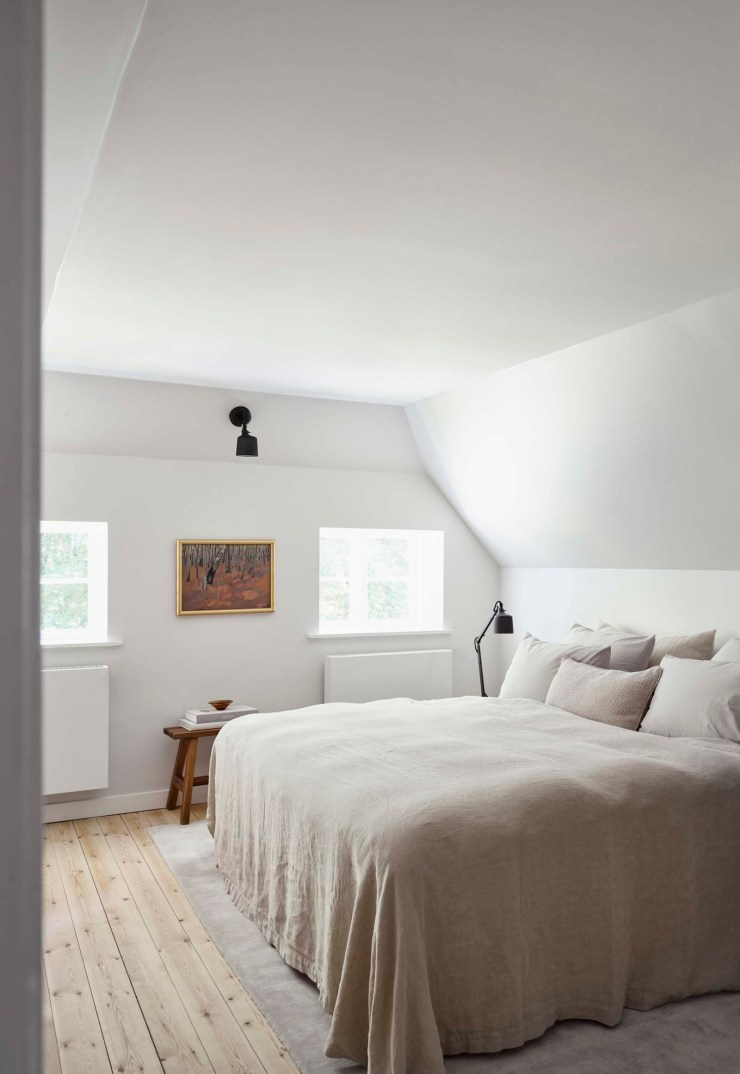 Minimalist white and beige bedroom at the Vipp Farmhouse - a Scandinavian holiday cottage deep in the Danish countryside   These Four Walls blog