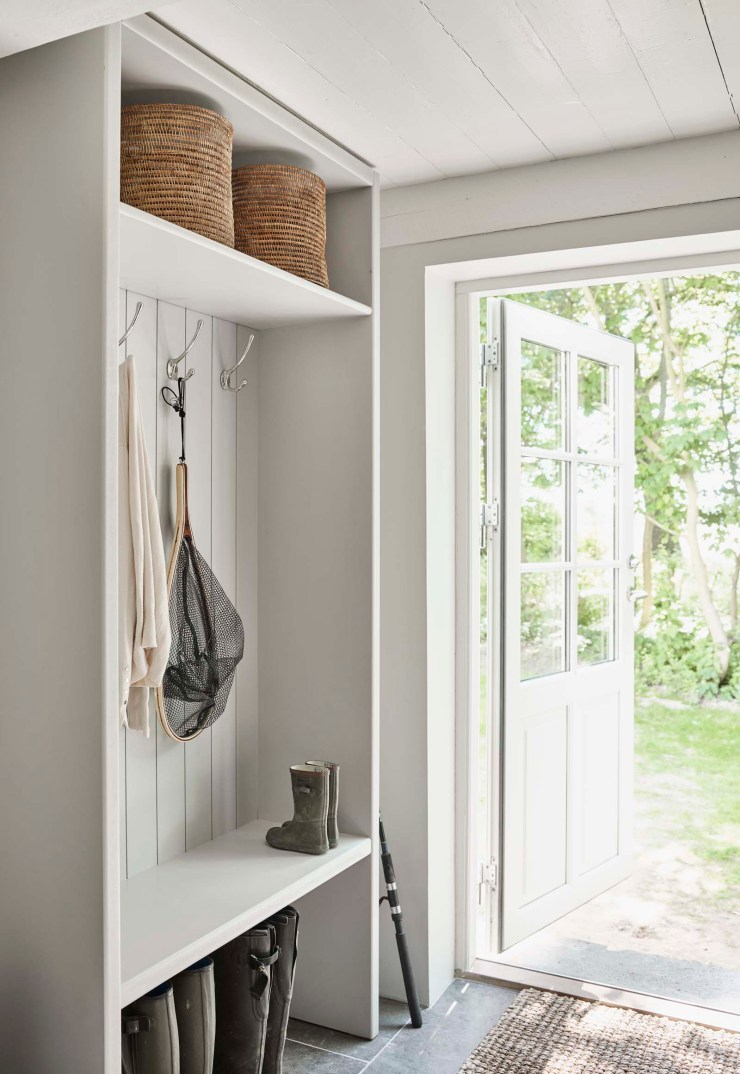 White entrance hall with shoe storage bench and tongue-and-groove wall panelling   Rustic-minimalism at the Vipp Farmhouse - a designer holiday cottage in the Danish countryside   These Four Walls blog