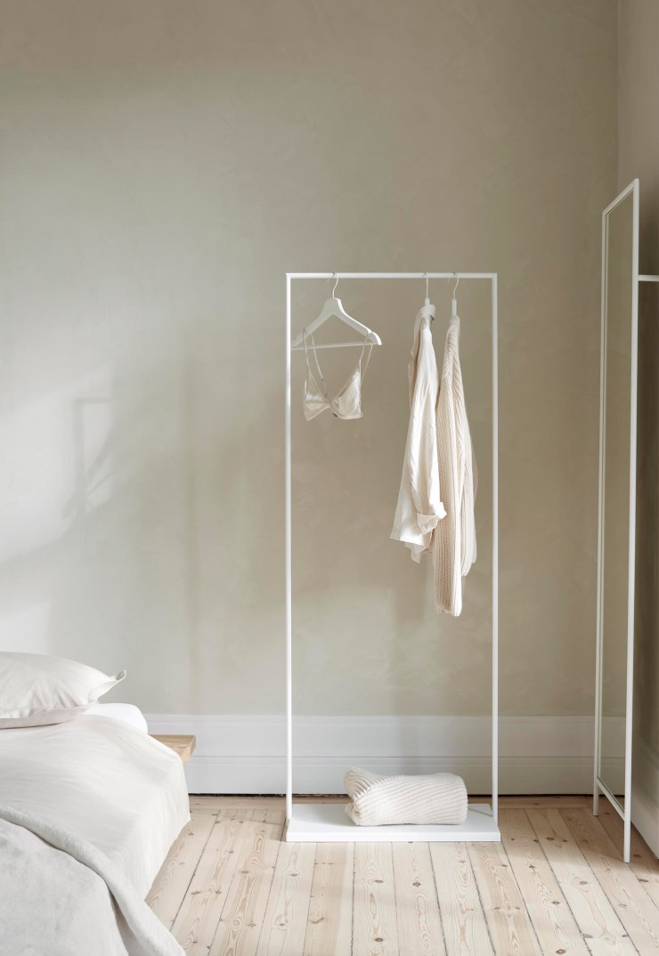 Minimalist clothes rail and mirror from Design Of in a simple beige bedroom | These Four Walls blog
