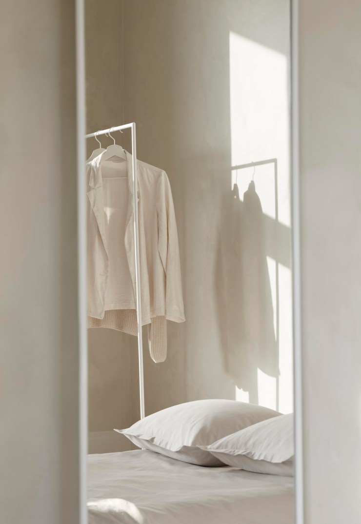 Minimalist clothes rail / coat rack by Swedish brand Design Of in a simple beige bedroom | These Four Walls blog
