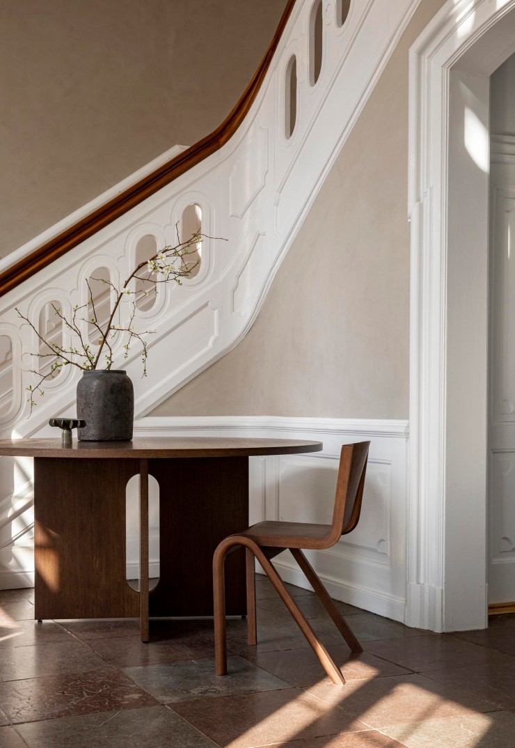 Historic building with beige walls and minimalist oak furniture from Danish design brand Menu   These Four Walls blog