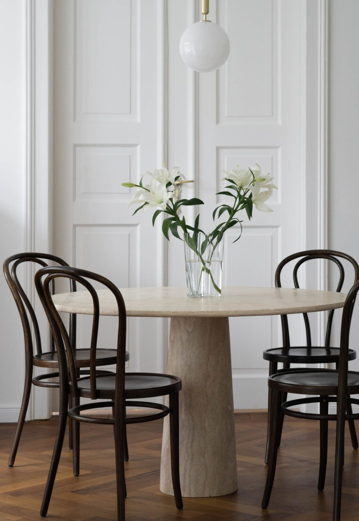 Minimalist dining room featuring Thonet chairs and circular marble table by Rebecca Goddard | These Four Walls blog