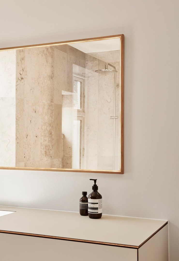 Contemporary minimalist bathroom with beige vanity unit and stone tiles   These Four Walls blog