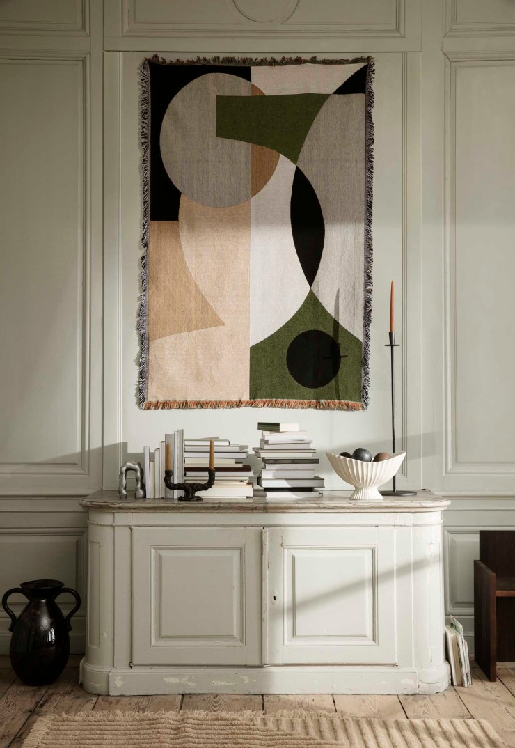 Contemporary tapestry wall hanging in a panelled beige and green interior | The autumn-winter 2021 collection from Ferm Living | These Four Walls blog