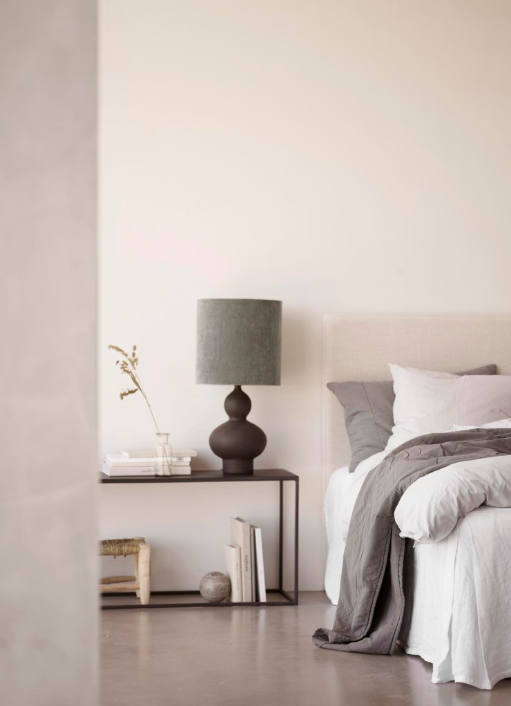 Minimalist monochrome bedroom with black bedside table and grey bed linen from Tine K Home's latest collection | These Four Walls blog