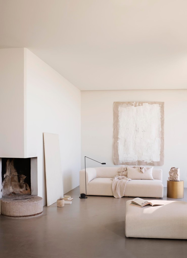 Relaxed beige living room with black floor lamp and low-slung sofa | Soft minimalism from Tine K Home's latest collection | These Four Walls blog