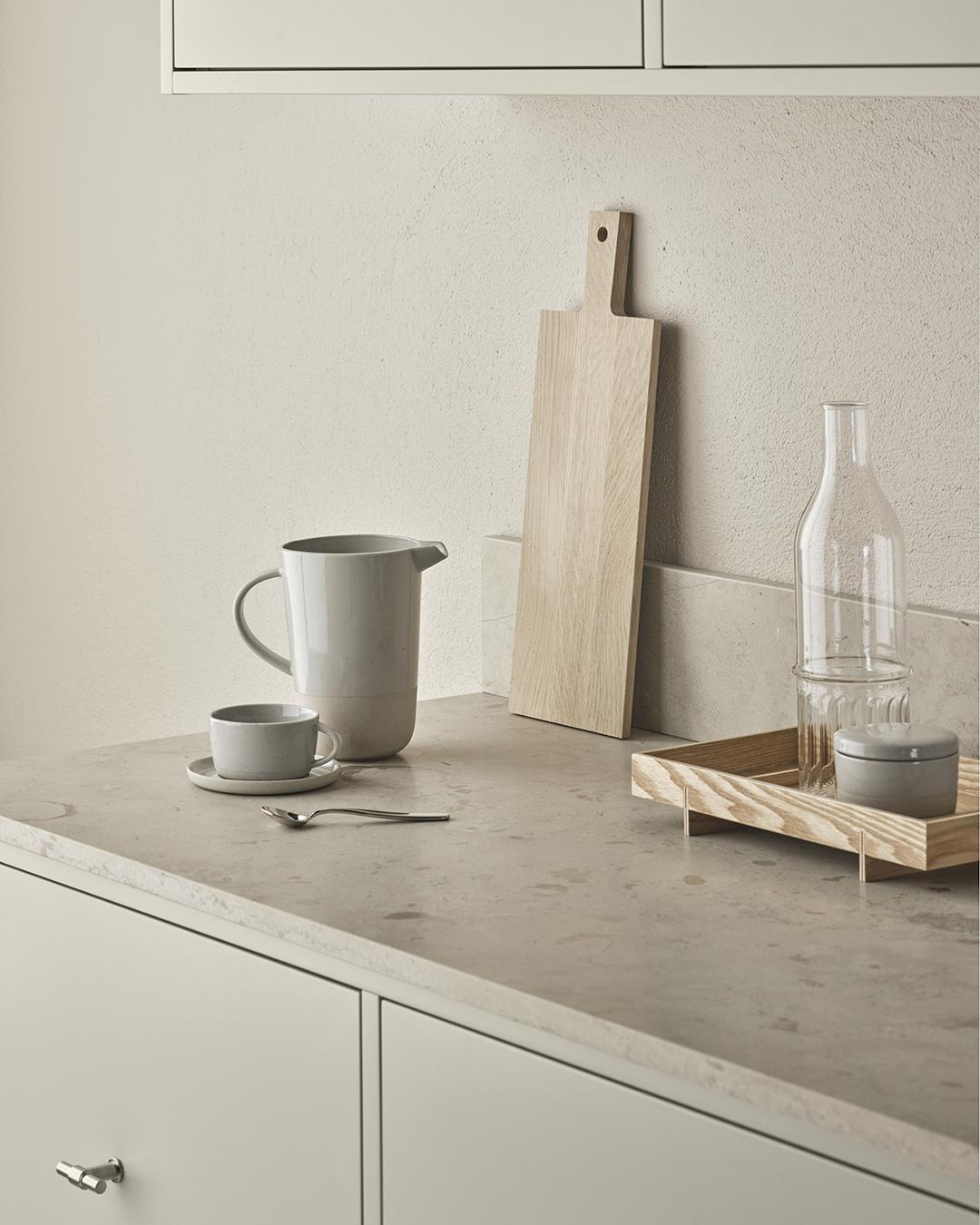 Minimalist Scandinavian kitchen with grey cupboards, stone worktops and oak chopping board | Eight inspiring kitchen ideas from Nordiska Kök's new showroom | These Four Walls blog