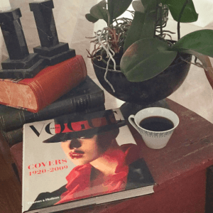 Table top still life pic, plant,coffee and art book