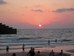 """On the beach in Haifa with dozens of others at sunset, we can only say: """"Lechayim."""""""