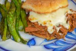 Try this Crock Pot French Dip Au Jus for some juicy, tender and cheesy beef sandwiches that the entire family will enjoy.