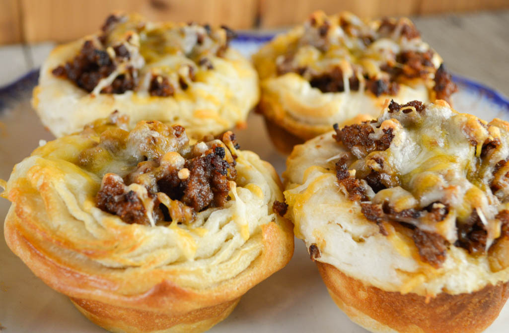 Sloppy Joe Cups have all the flavor of the classic sandwich in an easier to eat package - a biscuit - and topped with yummy cheese.