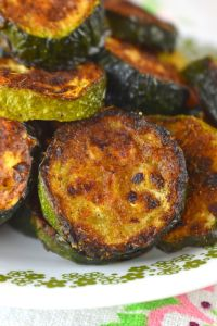 Spicy Roasted Zucchini is a recipe for baked zucchini slices with the perfect amount of spice. Serve along any dish for the perfect side. The gentle spice of this Spicy Roasted Zucchini makes it a perfect side dish for any meal, especially when you need a dish using easy ingredients.