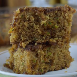 Butterscotch Zucchini Cake is an old fashioned recipe for a no frosting zucchini cake. With its crunchy, sugary topping made of butterscotch chips, cinnamon and sugar, there's no need to add a frosting. It's a go-to option for any cookout, pitch-in or just a mid-week treat.