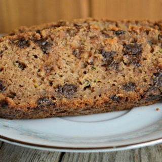 This Moist Chocolate Chip Zucchini Bread features non-traditional ingredients, like honey and applesauce, to make it a less guilty treat for the family