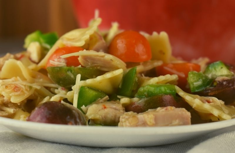 Served warm or cold, this Chicken Bow-Tie Pasta Salad is easy to double or triple for a crowd. With fresh vegetables and chunks of chicken, it is perfect to make ahead and enjoy all week long.