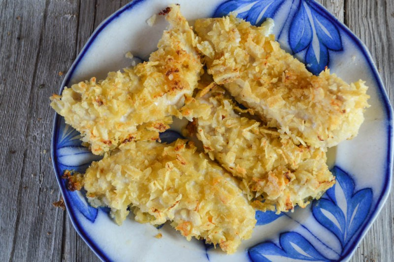 Crispy Potato Chip-Crusted Baked Chicken Tenders are a great way not only to satisfy your children's demands for their favorite entree but also use up the crumbs at the bottom of those potato chip bags.